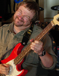 Scotty West improvises on his red guitar, he know that soloing is more than just knowing where to put your fingers.