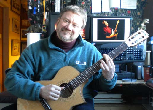 Scotty West playing nylon string classical guitar in his teaching studio.